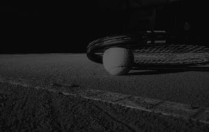 tennis racket ball on court